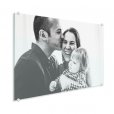 Photo on plexiglass of young family